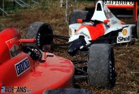 Senna clinches second world championship by taking Prost out