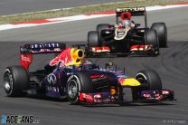 Vettel weathers Lotus onslaught for home victory