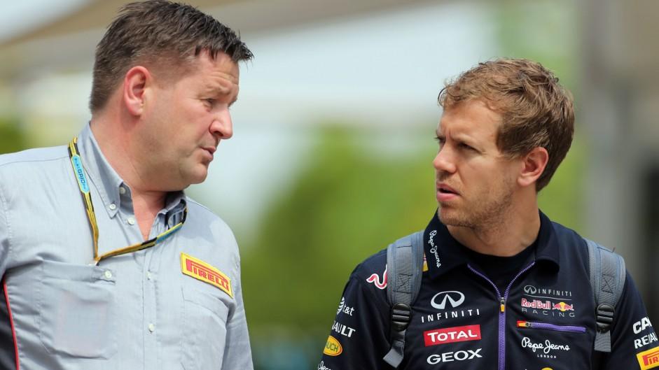 Paul Hembery, Sebastian Vettel, Sepang International Circuit, 2014