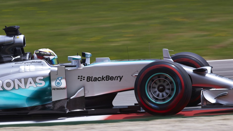 Hamilton frustrated by slow pit stops