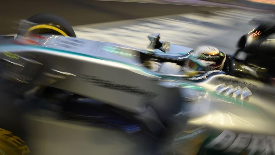 Hamilton hits the top, Maldonado hits the wall