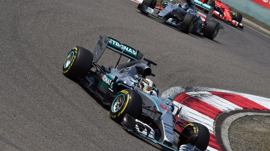 Hamilton holds off Rosberg for victory in China