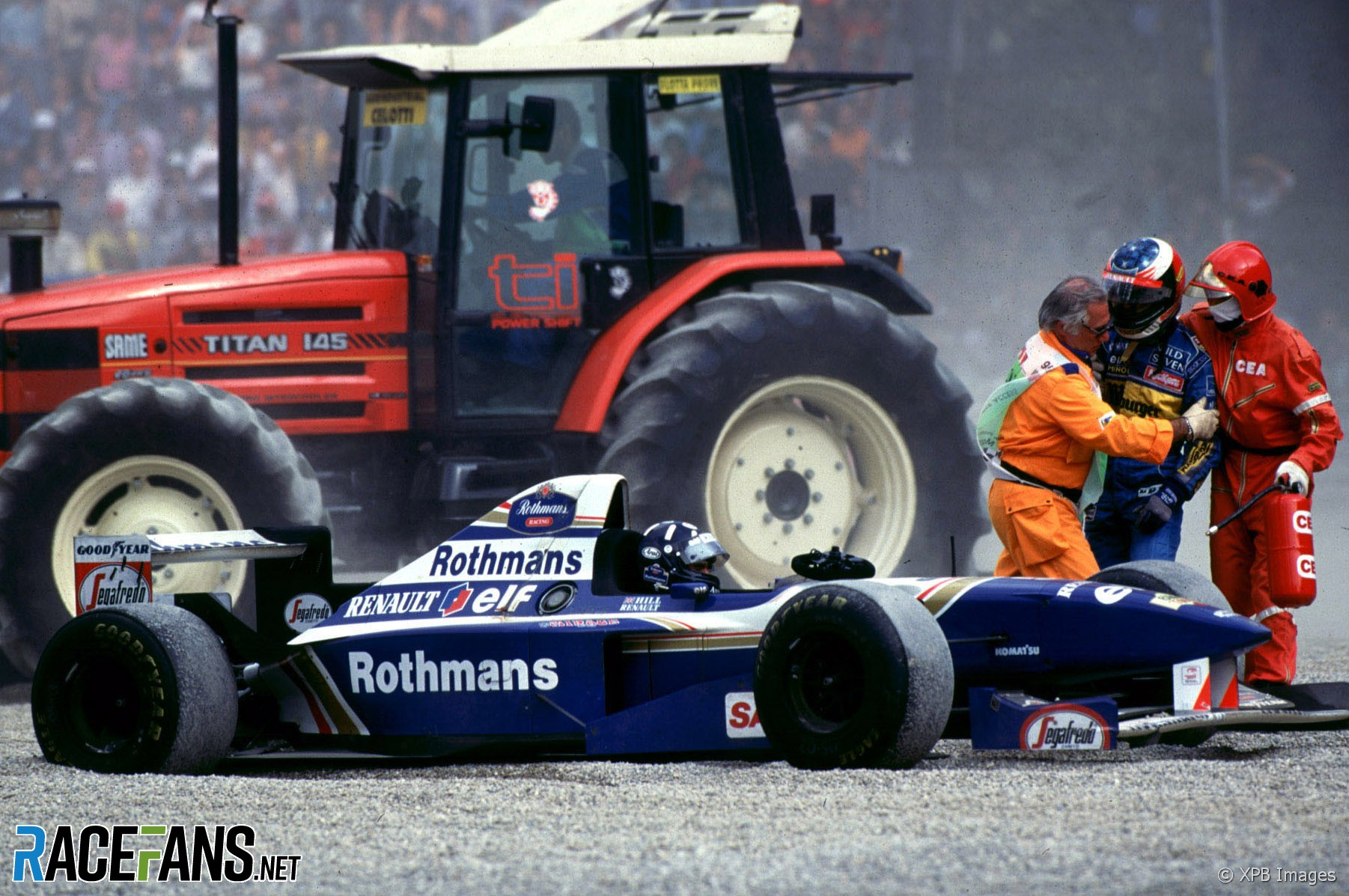 Marshalls keep Michael Schumacher away from Damon Hill after their collision, Silverstone, 1995