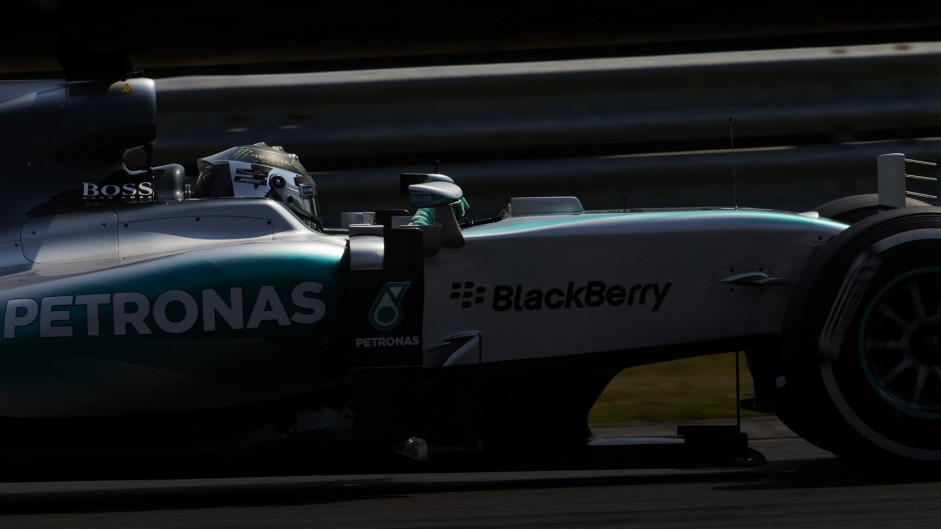 Rosberg takes pole after Kvyat rolls his Red Bull
