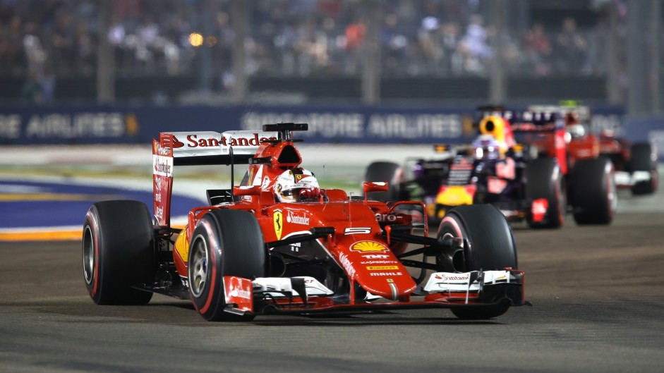 Vettel wins after track invasion in Singapore