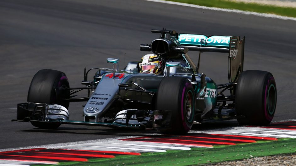 Hamilton takes victory after last lap clash with Rosberg