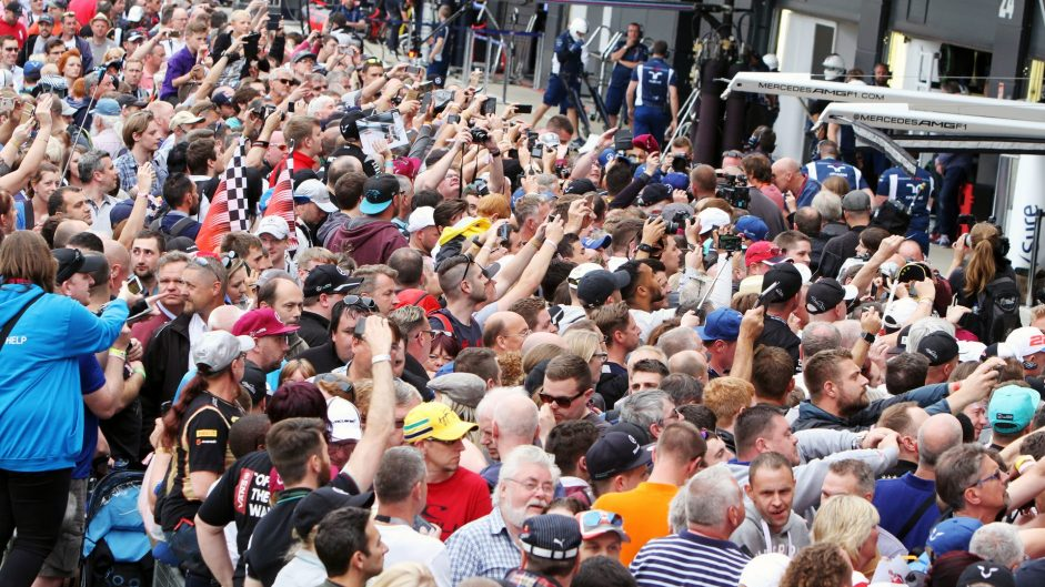 Fans in the pit lane. 07.07.2016. Formula 1 World Championship, Rd 10, British Grand Prix, Silverstone, England, Preparation Day. - www.xpbimages.com, EMail: requests@xpbimages.com - copy of publication required for printed pictures. Every used picture is fee-liable. © Copyright: Bearne / XPB Images