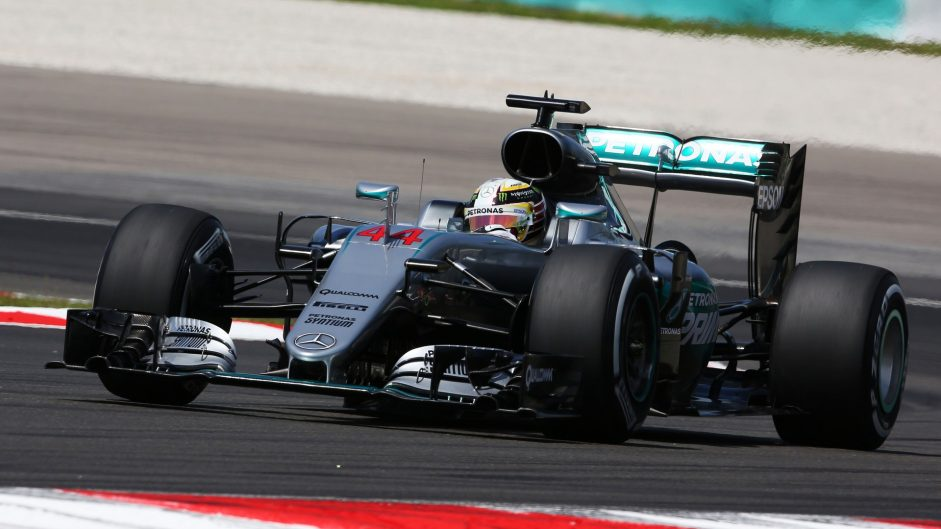 Hamilton sets the pace at scorching Sepang