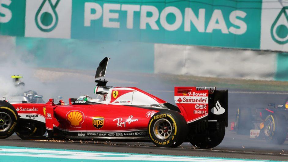 Vettel says Rosberg collision was racing incident