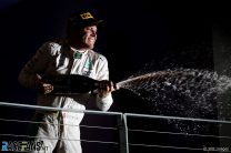 Rosberg hangs on to grab Singapore win and championship lead