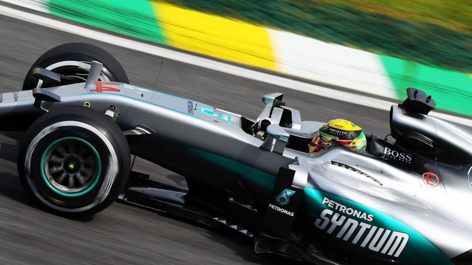 Hamilton beats Rosberg to pole in tense session