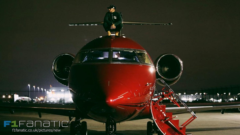 Leiws Hamilton on his aeroplane