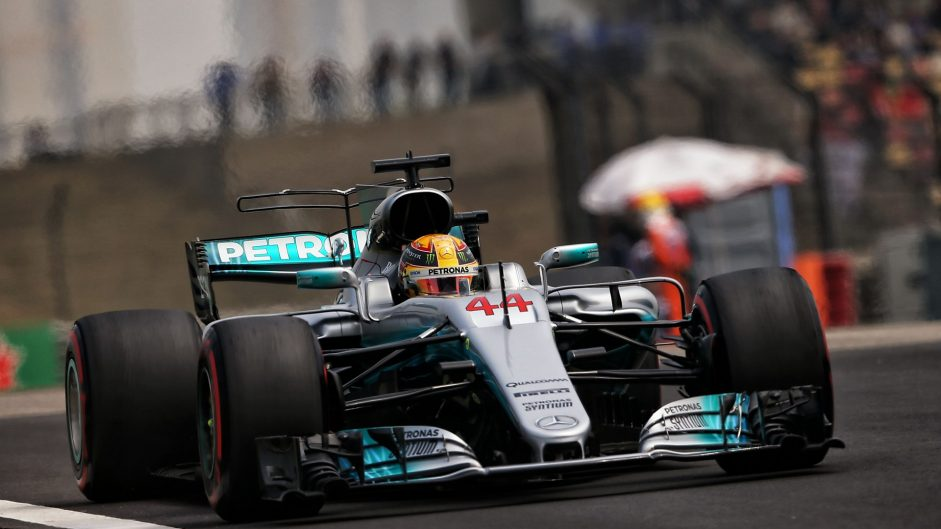 Hamilton resists Ferrari pressure for pole