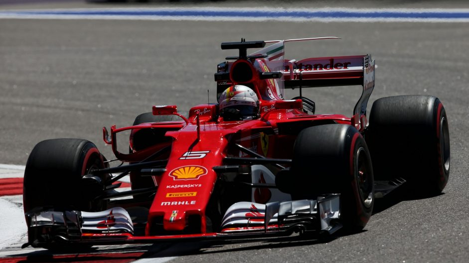 Vettel heads Ferrari front row after tight qualifying session