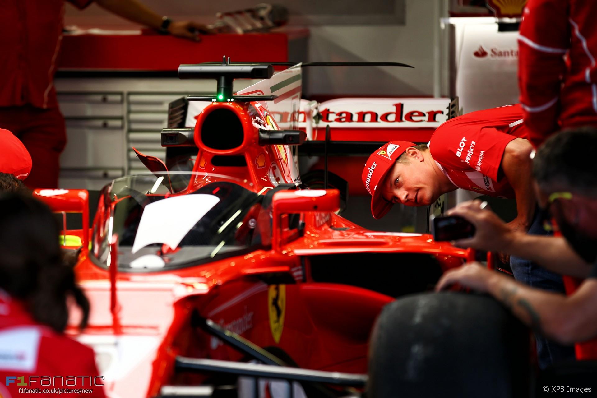 Kimi Raikkonen inspects the Shield, Ferrari, Silverstone, 2017