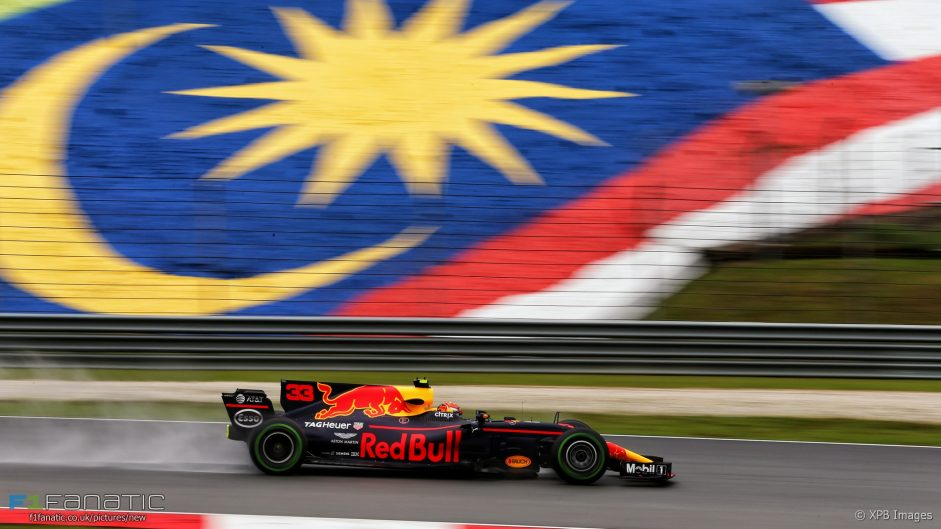 Verstappen leads Red Bull one-two in rain-hit session