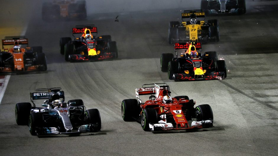 Hamilton wins frantic Singapore Grand Prix as Ferraris crash out