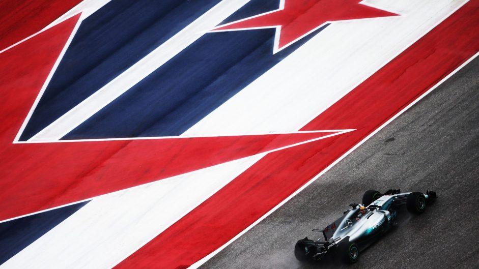 Hamilton leads Vettel in damp opening session