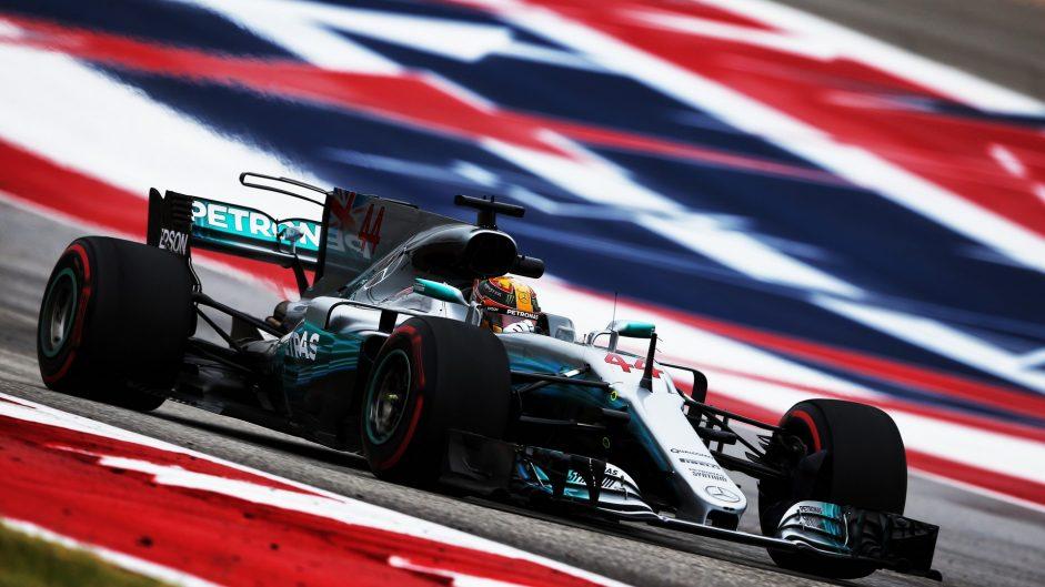 Hamilton stays on top while problem delays Vettel