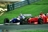 Villeneuve takes title as Schumacher's attack gets him thrown out