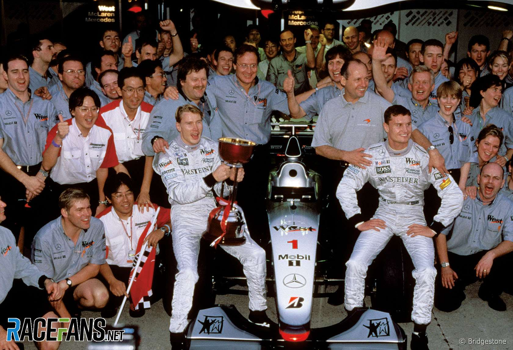 Mika Hakkinen, Norbert Haug, Ron Dennis, David Coulthard, McLaren, 1998
