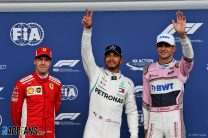 Hamilton snatches pole as Force India star at damp Spa