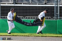 Marshals retrieve Daniel Ricciardo's wing, Albert Park, 2019