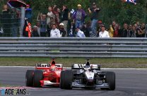 Hakkinen stuns Schumacher with three-wide pass for fourth win