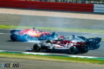 """Vettel says he was """"surprised by the kerb"""" in first-lap spin"""