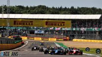 Zhou passes Piastri at start for Silverstone feature race win