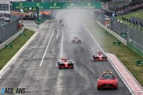 Hauger passes Leclerc for win at soaked Hungaroring