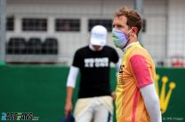 Vettel and three others reprimanded for wearing T-shirts during national anthem